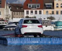car on a floating platform