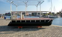 recreational pontoon boat with a solid roof support