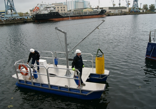 work boat with a lifting device