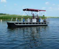 recreational pontoon boat with sun sail